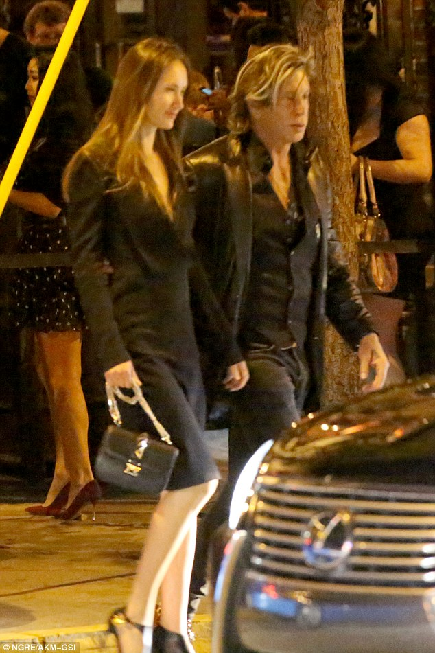 Mickey Rourke Shows Off New Blonde Locks As He Escorts
