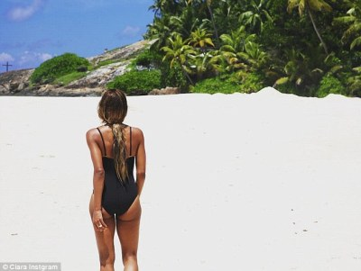 Cheeky: Ciara also flaunted her pert derriere in another photo, as well as her new ring as she was snapped walking away from the camera