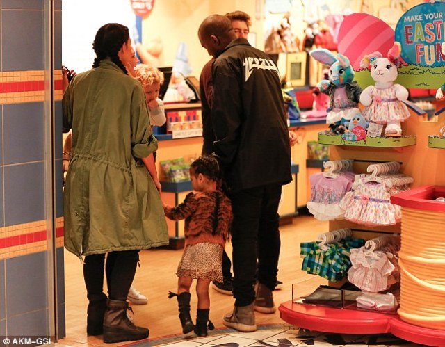 Maybe she was getting a bunny? North was seen walking past the Easter Fun stand that showed off little bunnies in dresses and shorts