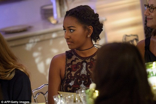 Sasha, 14, sat at the same table as actress Blake Lively, Reynolds's wife. Trudeau praised the Obama girls and said they'd had a 'remarkable childhood', adding:'That will give you extraordinary strength and wisdom beyond your years for the rest of your life'