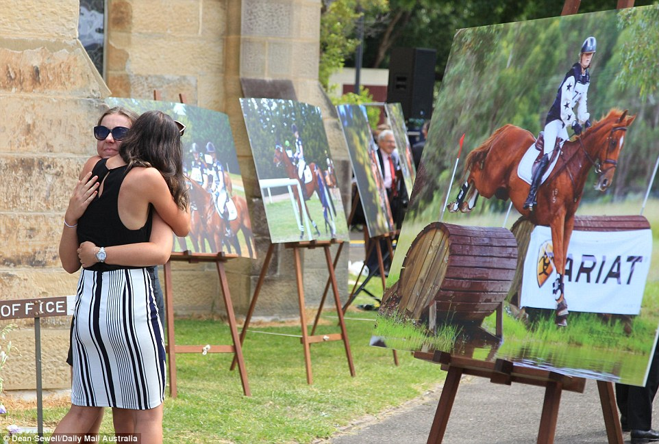 Large portraits were on display outside the church where Olivia Inglis' funeral was held in Randwick in Sydney's east on Monday
