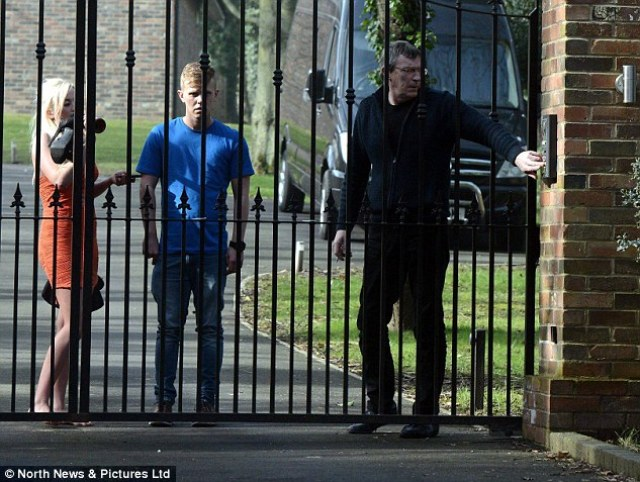 The player's father, Dave Johnson, then emerged from the mansion and opened the gate for the pair