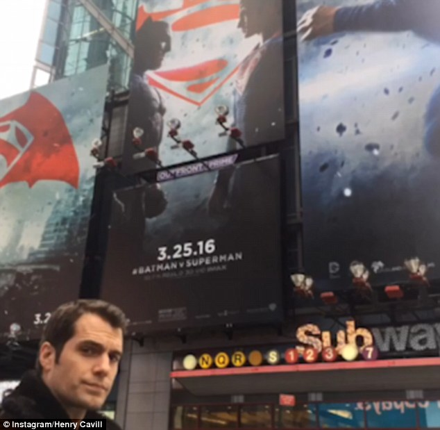 Casual: The Man of Steel star took a close-up selfie next to one of the gigantic movie posters