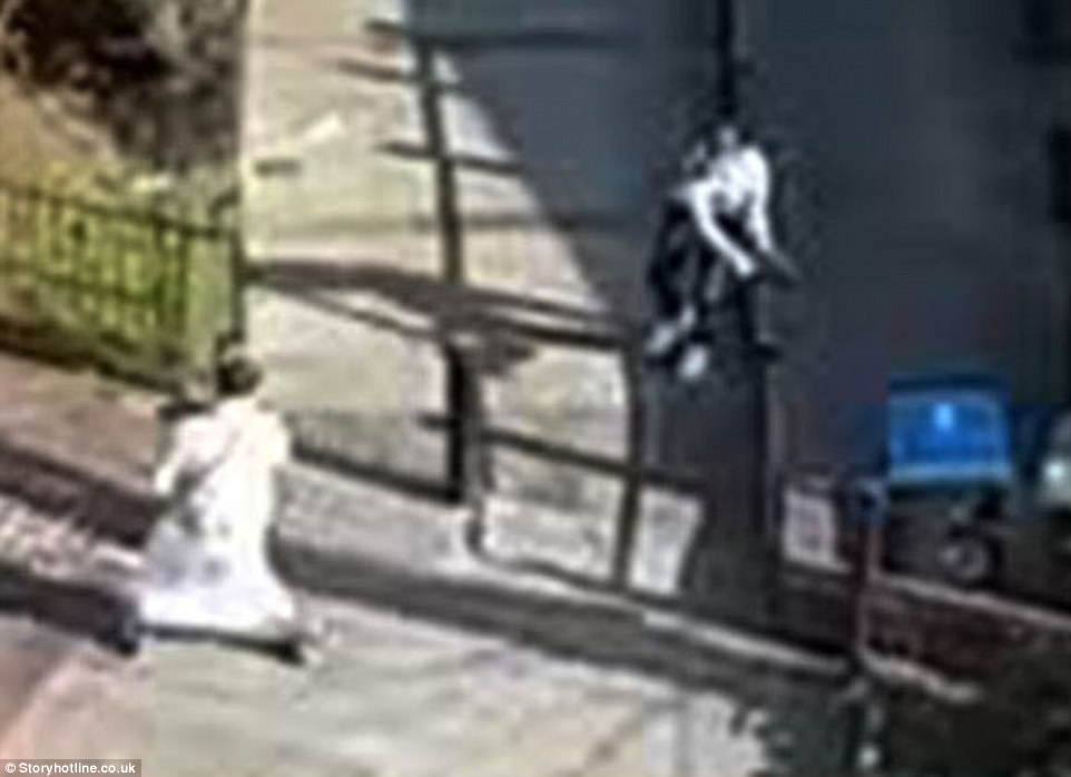 The victim then desperately tries to scramble up the pavement away from his attacker, who appears to give up before running up a nearby busy road