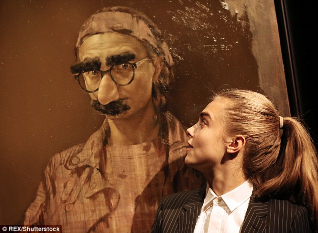 The big reveal: Cara, 23, was pictured admiring a Groucho Marx-style image of herself as she attendedJonathan Yeo's Portraits exhibition at the Museum of National History in Frederiksborg Castle