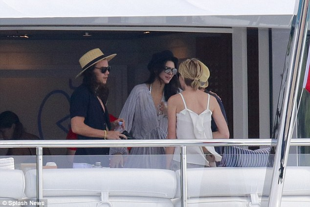 Pictures of Harry Styles and Kendall Jenner vacationing in St Barts have been leaked and are circulating on Twitter. These images are not from the iPhone but were taken around the same time as the leaked photos