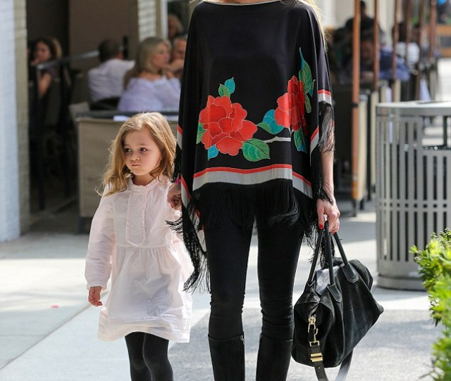 Girls Day Out Kimberly Stewart Donned A Rose Themed Poncho As She Took Daughter