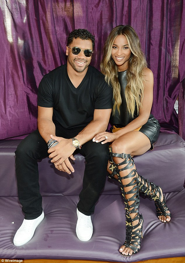 He's here! Russell Wilson wasn't far from his new fiancée's side and joined her at the event