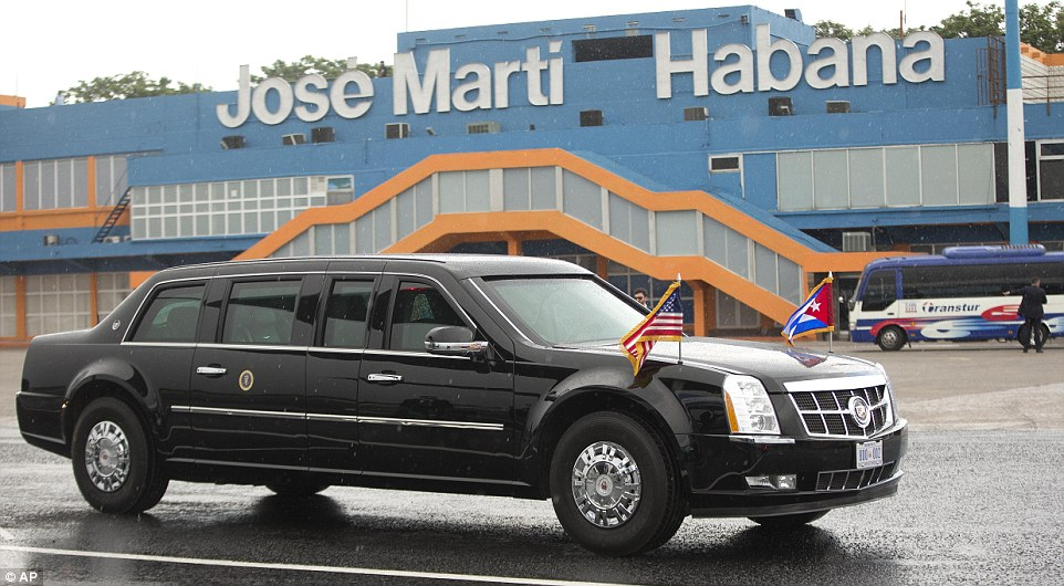 Cuban and American flags were flown from the president's car as it left the airport in the direction of Havana's Old Town, where he will be given a tour this evening