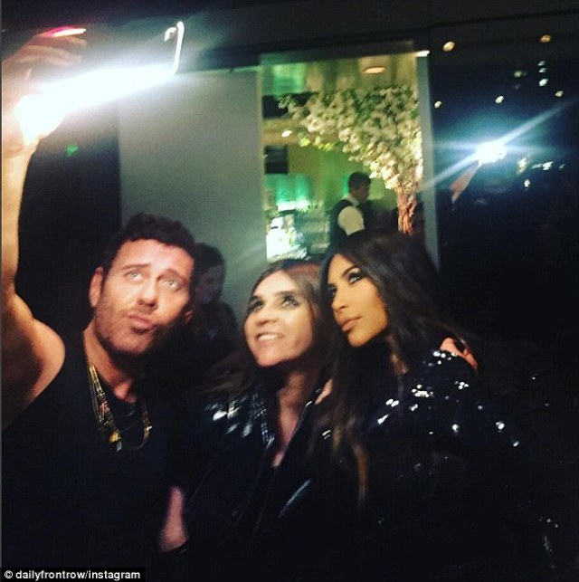Always time for a selfie! Kim posed for a selfie withphotographer Mert Alas and Carine