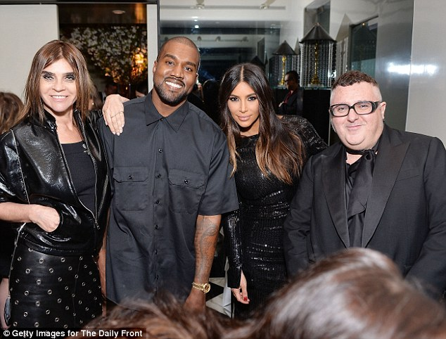 In style: The couple cozied up to Vogue Paris editor Carine Roitfeld and designer Alber Elbaz