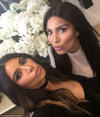 'It was so fun to run into her': Kim Kardashian (L) shared a selfie with her doppelganger Kamilla Osman on her website on Monday