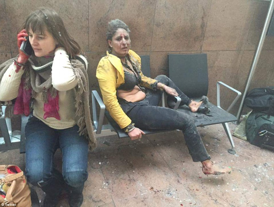 Shocking: Injured passengers are covered in blood and dust after the explosions rocked the terminal building at Brussels Airport
