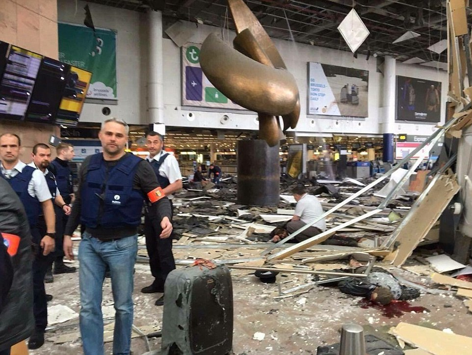 Carnage:At least eleven people have died and several  injured after two explosions rocked Brussels Airport in a suspected terror attack