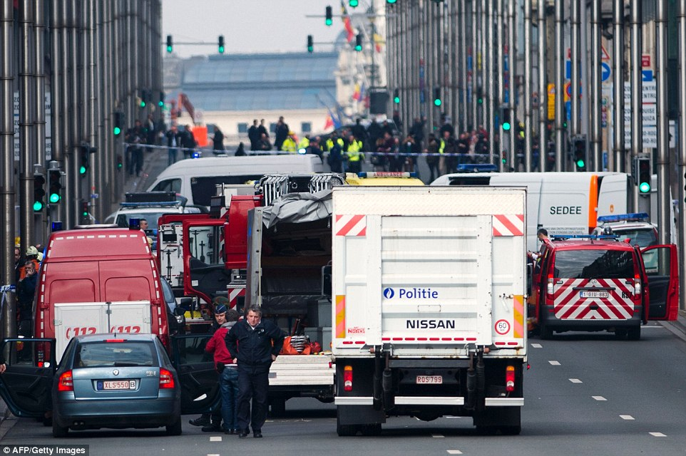 Lockdown:Rue de la Loi, which runs outside the station, is sealed off by police and emergency services in the wake of the 9.19am attack