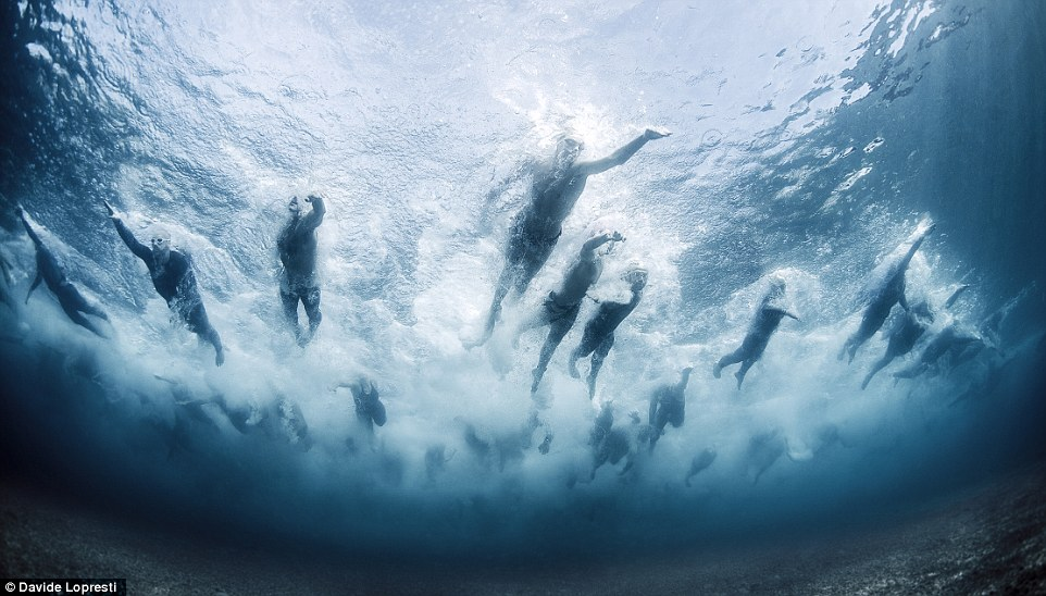 During the Swim the Island contest in Liguria, Italy, a competition in which hundreds swim in the sea and compete over a distance of six kilometers, photographer Lopresti snapped away as the athletes made a circle around the island of Bergeggi