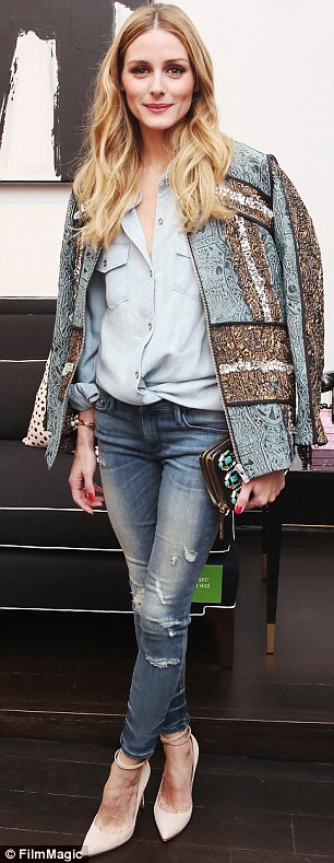 At the double: She seemed to be positively relishing the chance of playing fashion Russian roulette with her denim-heavy ensemble
