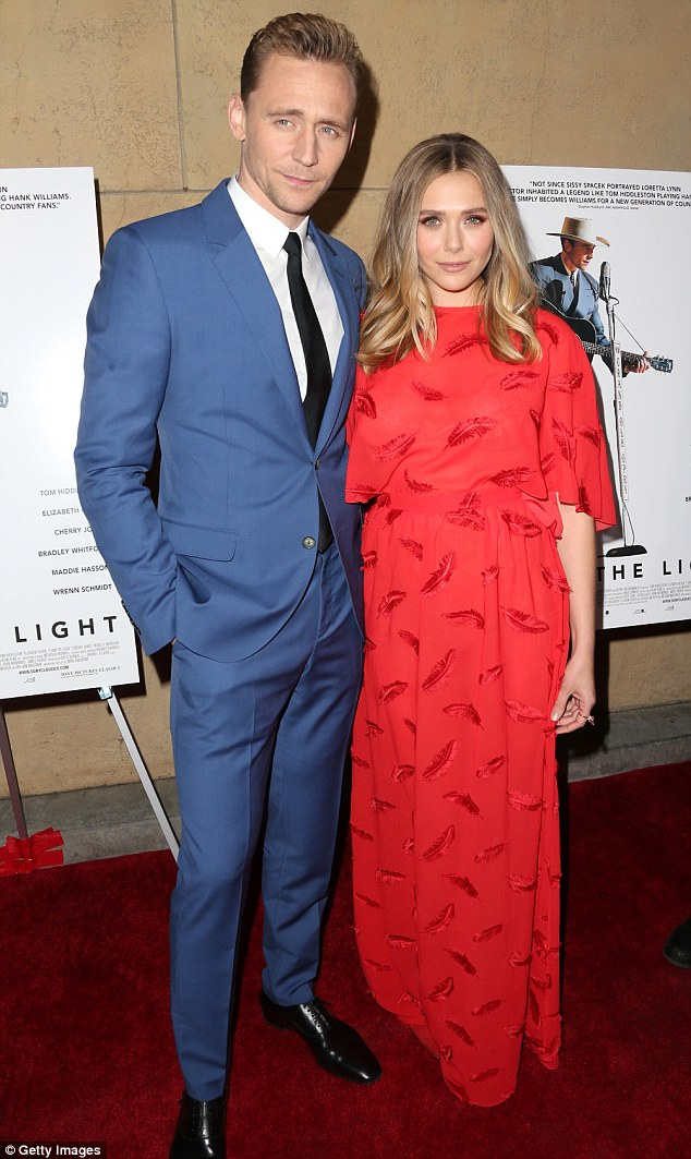 Costars: Tom Hiddleston, who plays the country legend, looked sharp in a blue suit