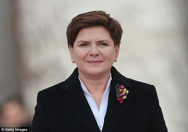Polish Prime Minister Beata Szydlo (pictured) today said she was 'not OK' with allowing migrants to settle in her country following the attacks in Brussels