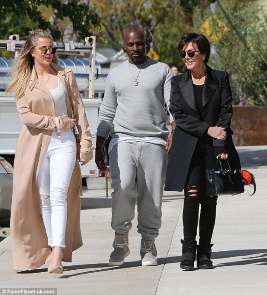 Yin to her yang: Kris sported the opposite of Khloe's light look