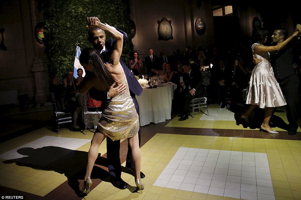 Obama (pictured dancing the tango in Buenos Aires as wife Michelle dances behind him, right) has appealed for calm in the wake of the attacks in Brussels, saying that by reacting with fear other politicians are playing into the terrorists' hands