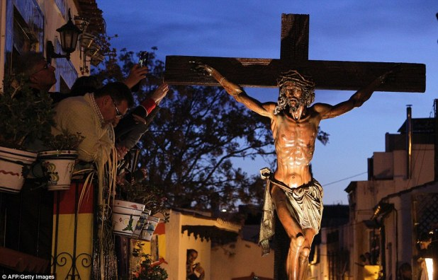In nearby Alicante, an effigy of Jesus Christ nailed to the cross is carried through the city streets at night