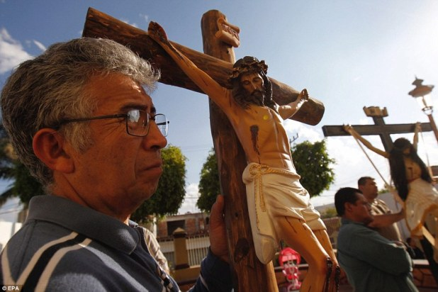A man watches the ceremony take part during the week Holy Week - which runs for one week worldwide up until Easter Sunday