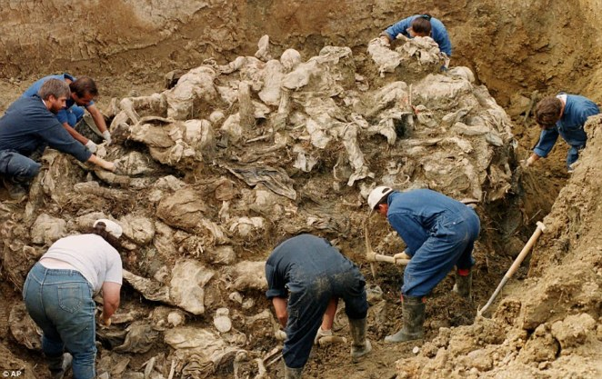 Digging up the dead: International War Crimes Tribunal investigators clearing away soil and debris from dozens of Srebrenica victims buried in a mass grave near the village of Pilica