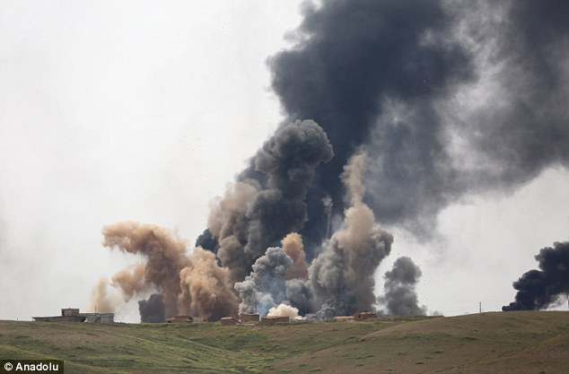 A US-led coalition has been attacking ISIS positions in villages surrounding Mosul, pictured