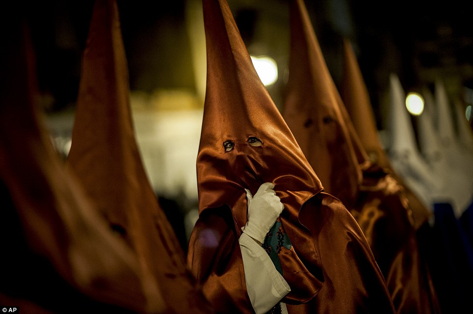 Masked penitents take part in the procession of the 'Santa Veracruz' brotherhood, during Holy Week in Calahorra, northern Spain