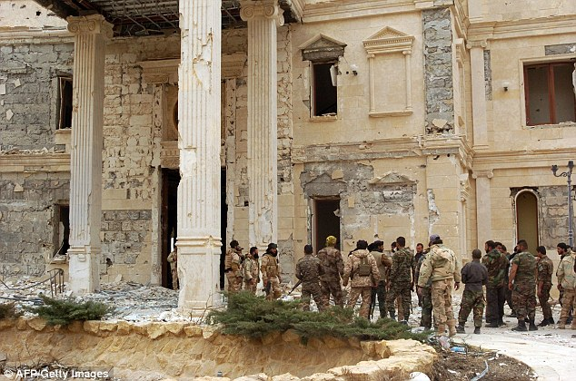 Pictures have emerged of Syrian troops standing next to a mansionbelonging to the Qatari royal family in the ancient city of Palmyra on March 24