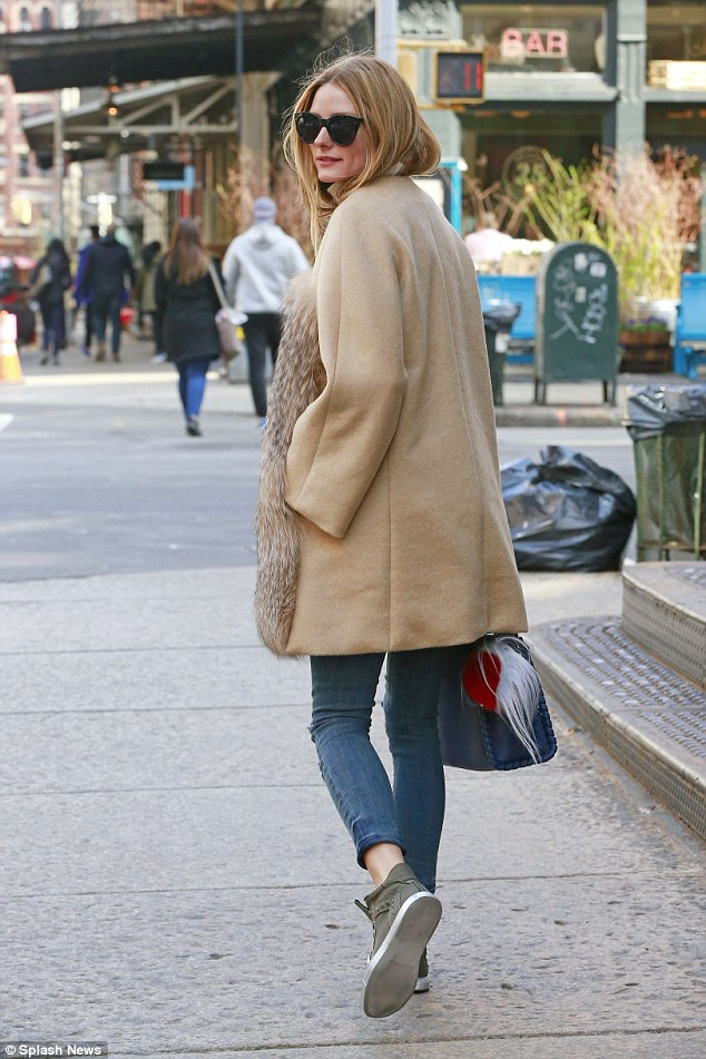 Smart casual: The American beauty kept the remainder of her outfit casual, with some skinny torn jeans and khaki kicks