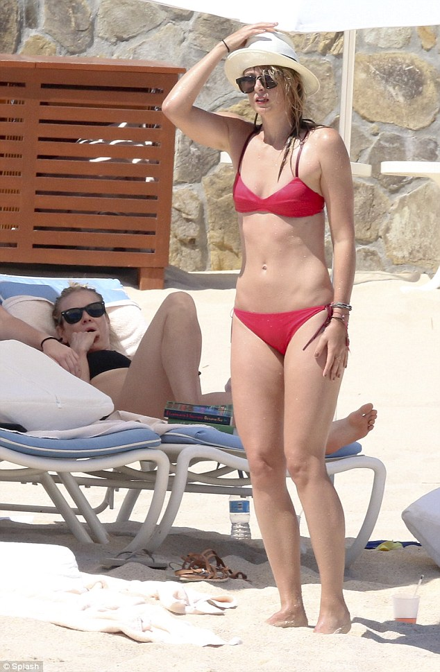 Good pals: After an onslaught of professional woes, Maria Sharapova was spied living it up in Mexico with good friend Chelsea Handler on Monday, as they continue a sun-soaked getaway