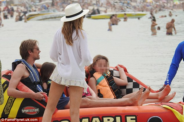 Strapping them in: Abbey was ready to watch her husband and daughter enjoy themselves in the ocean