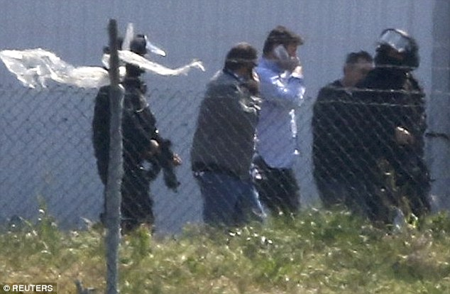 Unidentified people leave the hijacked Egyptair Airbus A320, with Mustafa believed to be second from right