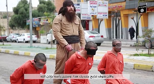 A Kurdish ISIS militant has been videoed beheading three prisoners in an extremely graphic ISIS video purportedly filmed in Iraq