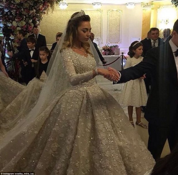 Khadija's dress was imported from Paris and reportedly weighed 25lb thanks to the huge train and heavy embellishment. The  bride needed the assistance of several people to carry her train and help her walk upstairs