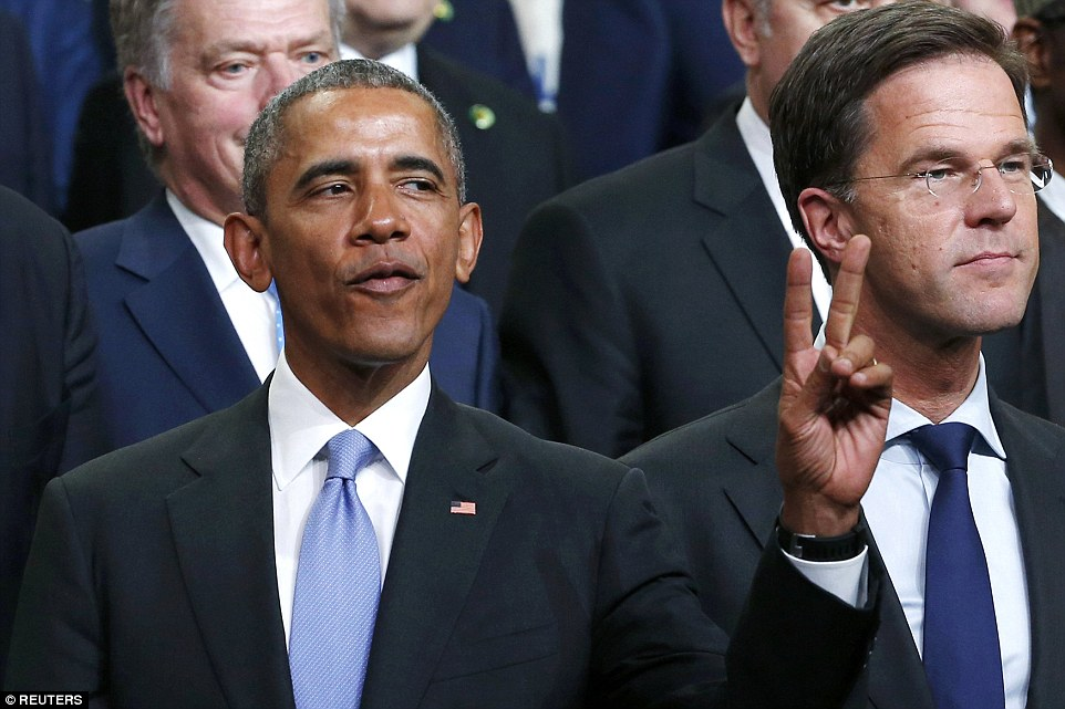 Cool customer: Despite facing criticism for appearing too relaxed in his final year as president, Obama looked chilled as he posed for the photograph while pulling out the peace sign