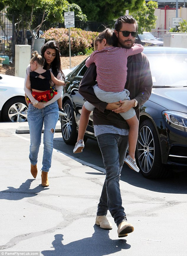 Rolling along: Kourtney and Scott took their kids Penelope and Mason to a roller rink in Glendale, CA where they filmed Keeping Up With The Kardashians with members of her family