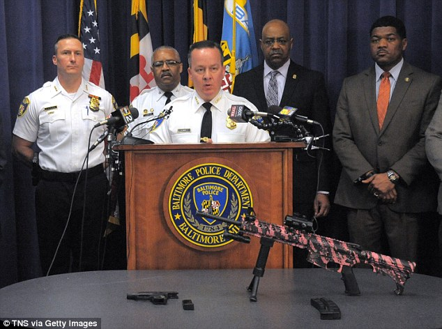 Baltimore police held a press conference on Friday where they identified the men as father and son and displayed the weaponry the men were brandishing (pictured)