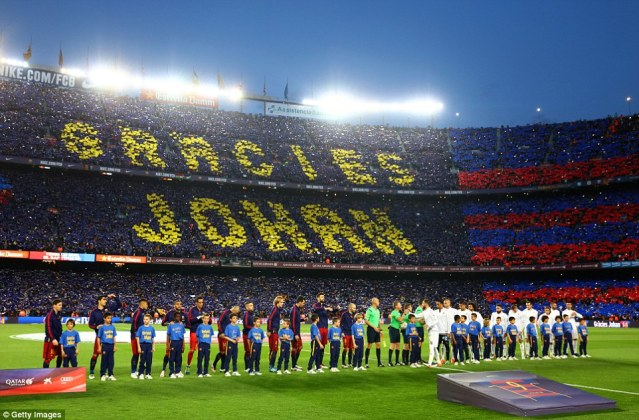 The capacity crowd packed into the Nou Camp unveil a mosaic tribute to former Barcelona player and manager Johan Cruyff before kick-off