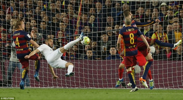 Karim Benzema gets the visitors back into the contest with an acrobatic effort in the Barca box