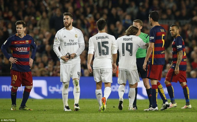 Real defender Sergio Ramos (second left) was sent off in the 82nd-minute for rash challenge on Luis Suarez