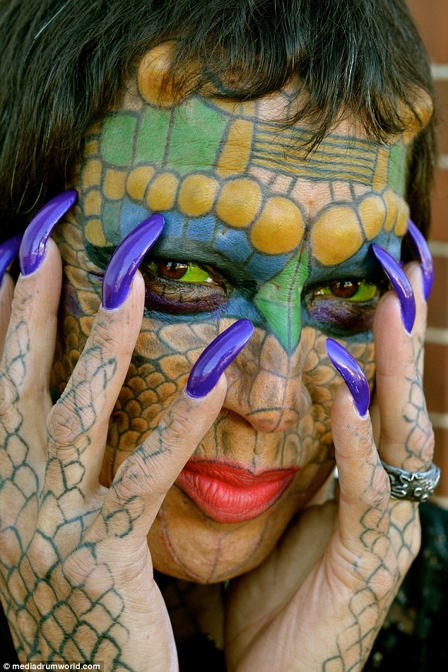 Dragon lady: Tiamat is November 2012, before undergoing nose and ear surgery. She has had extensive cosmetic treatments and body modification, including facial tattooing and 'horns' on her forehead (pictured)