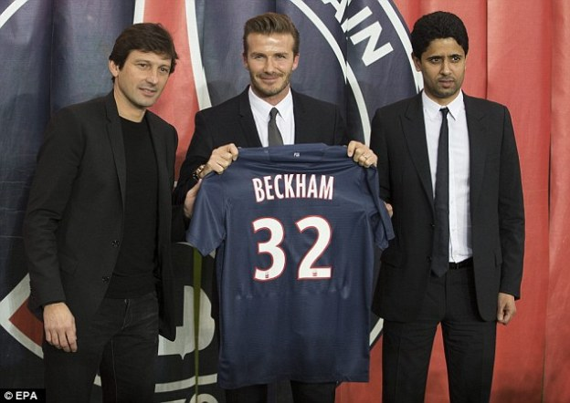 Sporting director Leonardo (left) poses alongside David Beckham (centre) and Al-Khelaifi in 2013