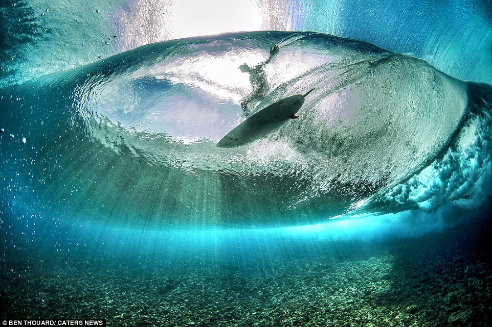 The beautiful pictures were taken from the bottom of the bright blue crystal-clear oceanoff the coast of Tahiti in French Polynesia