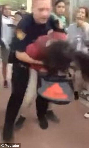 A San Antonio school police officer has been put on paid administrative leave after a video of him body-slamming a 12-year-old onto her face surfaced online