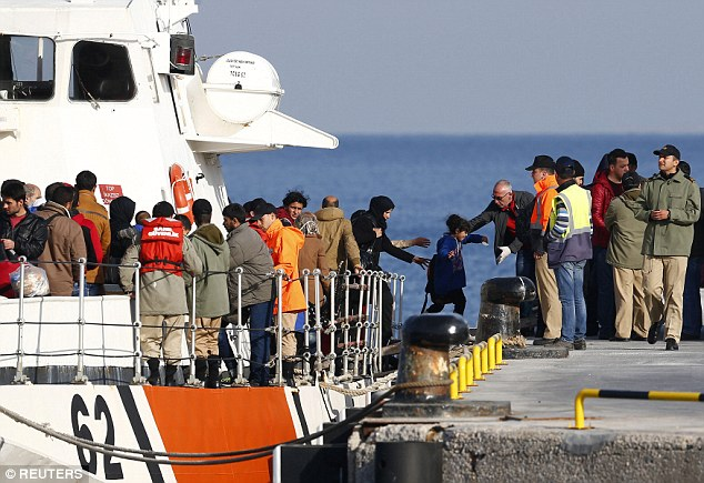 Migrants disembark from a Turkish coastguard boat after a failed attempt crossing to the Greek island of Lesbos from the Turkish coastal town of Dikili
