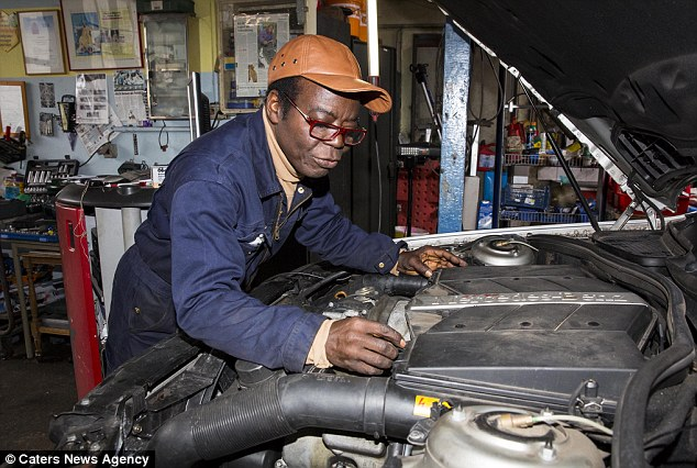 The 67-year-old's official royal status is 'King Togbe Ngoryifia Cephas Kosi Bansah' - but he spends most of his time in oily overalls fixing cars