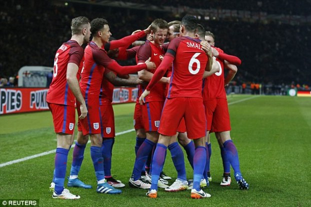 Eric Dier (centre) is congratulated by his England team-mates after scoring the winner against Germany
